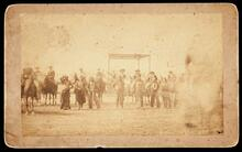 """William F. """"Buffalo Bill"""" Cody saluting the audience at a Wild West show"""