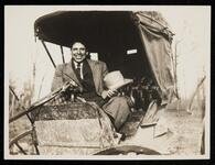 Unidentified Native American man in a carriage