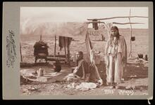Two unidentified Apache women by the lean-to