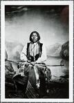 Kiowa brave in war dress