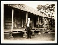 Unidentified man in front of Cabin