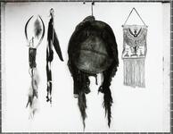Cow shield, cow-horn headdress, bridle pendent, and pouch used by Tsentainti, a Kiowa raider