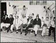 Tribal meeting, in front of Indian murals at Riverside boarding school, Anadarko