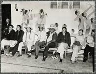 Tribal meeting, in front of Indian murals at Riverside boarding school, Anadarko