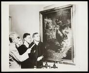 "Two black and white photos of sailors viewing William R. Leigh's painting ""Midnight Ride of Paul Revere"" in Boston"