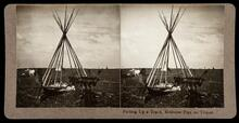 Putting up a tepee, medicine pipe on tripod