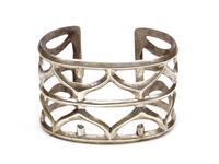 Sandcast silver bracelet with geometric designs