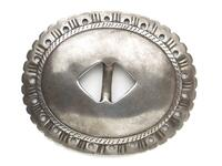 Silver, oval shaped, open-center belt concha with stamped scallop-edge design