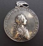 "George III peace medal with ""Happy While United"" type"