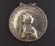 "Silver peace medal with ""Happy While United"" type"