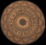 Large coiled basket tray with woven writing and geometric designs