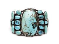 Large silver cuff bracelet with clusters of inset turquoise