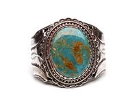 Large silver wire cuff bracelet with turquoise inset and embossed floral pattern