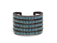 Silver needlepoint cuff bracelet with engraved sides and five rows of needlepoint turquoise inset