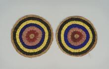 Circular beaded tipi ornament on buffalo hide