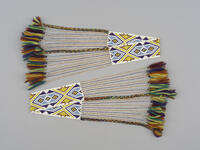 Men's beaded arm bands with geometric designs, beaded fringe and wool tassels