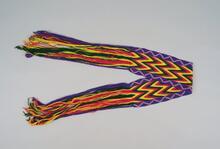 Osage woman's fingerwoven yarn sash with beadwork
