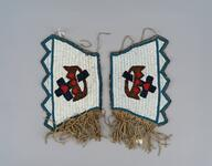 Beaded wrist cuffs with geometric design in red, white, blue and brown