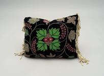 Black velvet pillow with beaded floral designs and buckskin backing