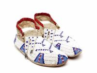 Beaded leather moccasins with split tongue and metal cone tassels