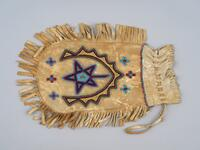 Hide bag with beaded design on one side