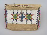 Possible bag with geometric beaded designs and metal cone ornaments with horse hair