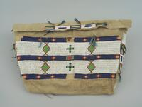 Hide possible bag with cone metal jingles and horsehair