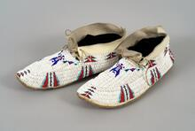 Men's beaded leather moccasins with geometric designs
