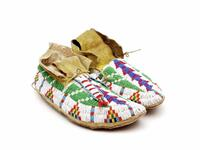 Beaded leather moccasins with geometric designs