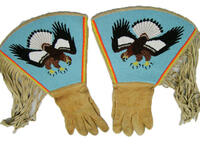 Gauntlet with beaded eagle design and fringe and printed cloth lining