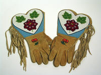 Buckskin gloves with beaded floral design and fringe