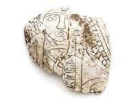 Pigmented incised shell fragment