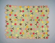 Cotton quilt with multi-colored star pattern and stylized boarder