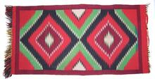 Navajo rug with fringe