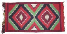 Navajo rug with fringe