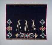 Beaded blanket with ribbon decorations