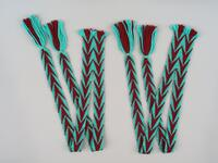 Fingerwoven sash of maroon and blue with fringe and beadwork