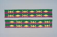 Green, purple, yellow, and white ribbon sash