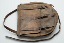 Worn light brown leather bag