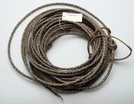 Dark brown woven lariat with a light brown leather strap