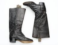 Pair of black leather boots with light blue striped fabric strips coming out of top