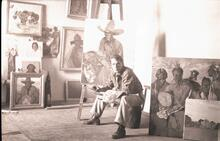Man at Easel Working on Painting of Cowboy