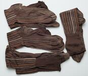 Four pairs of socks that are brown with white and rust-colored stripes