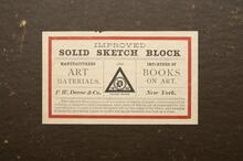 Solid sketch block with sheets of paper attached