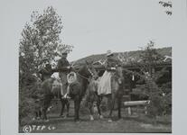 Photograph of Charles M. Russell with two others on horses