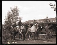 Charles M. Russell and two friends on horseback
