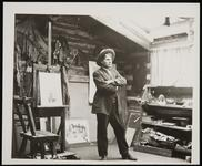 Charles M. Russell in his studio with art