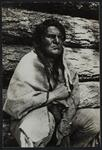 Charles Russell dressed as an Indian draped in a blanket