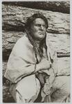 Charles M. Russell dressed as Indian draped in a blanket