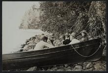 Charles M. Russell and Nancy C. Russell with friends on lake shore